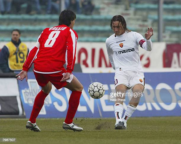 Dino Baggio of Ancona defends against Francesco Totti of Roma during the Serie A match Between Ancona and Roma at the Del Conero stadium on February...