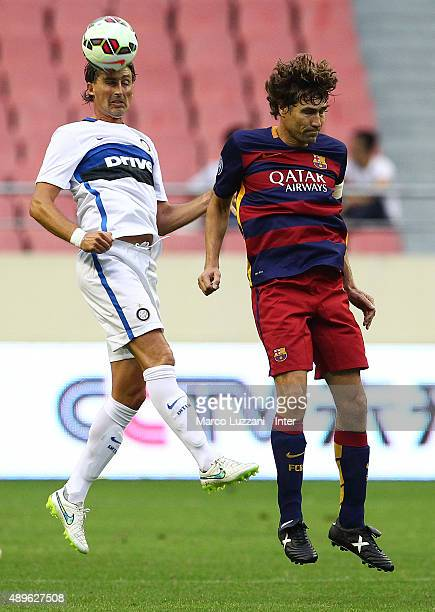 Dino Baggio of Inter Forever competes for the ball with Julio Salinas of Barcelona during the The 2015 Winning League International Legends...