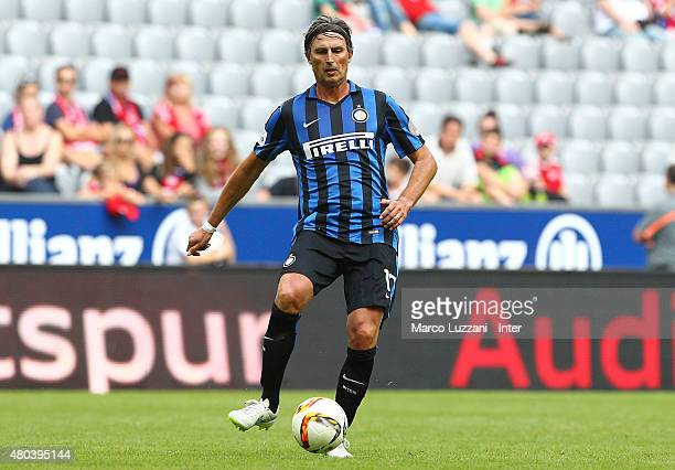 Dino Baggio of Inter Forever kicks a ball during the friendly match between FCB AllStars and Inter Forever at Allianz Arena on on July 11 2015 in...
