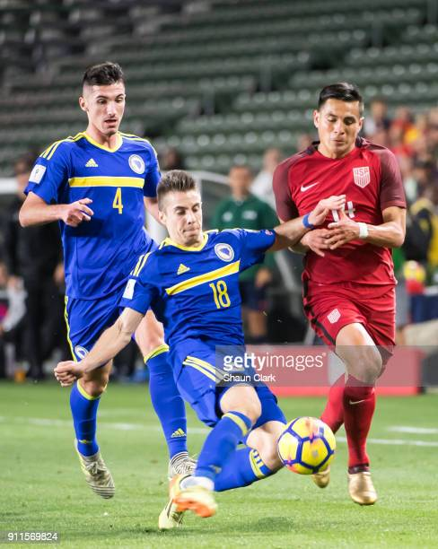 Dino Becirevic of Bosnia Herzegovina clears the ball as Rubio Rubin of the United States as during the international friendly match between the...
