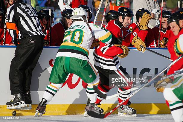 Dino Ciccarelli of the Minnesota North Stars/Wild defends Denis Savard of the Chicago Blackhawks during the Coors Light NHL Stadium Series Alumni...