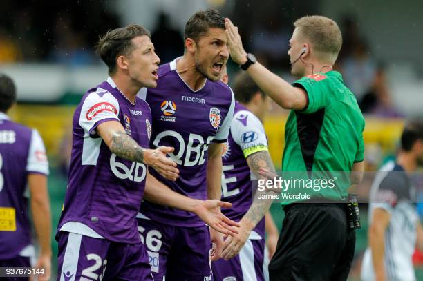 Dino Djulbic and Scott Neville react to field referee Adam Fielding during the round 24 ALeague match between the Perth Glory and the Melbourne...