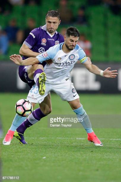 Dino Djulbic of Perth Glory defends against Bruno Fornaroli of Melbourne City during the ALeague Elimination Final match between Melbourne City FC...