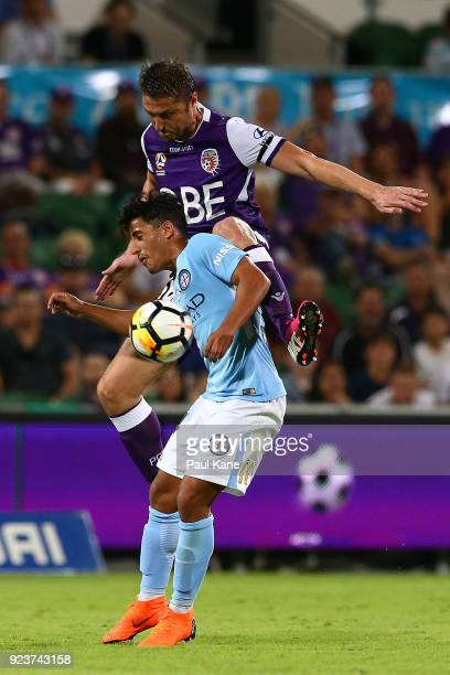 Dino Djulbic of the Glory and Daniel Arzani of Melbourne contest for the ball during the round 21 ALeague match between the Perth Glory and Melbourne...