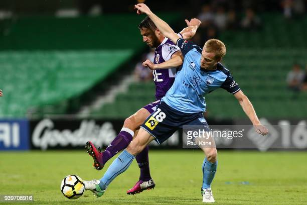 Dino Djulbic of the Glory and Matt Simon of Sydney contest for the ball during the round 25 ALeague match between the Perth Glory and Sydney FC at...