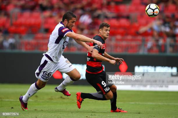 Dino Djulbic of the Glory and Oriol Riera of the Wanderers compete for the ball during the round 23 ALeague match between the Western Sydney...