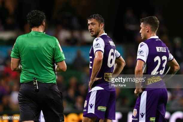 Dino Djulbic of the Glory looks to Referee Kris GriffithsJones after being issued a yellow card during the round 25 ALeague match between the Perth...
