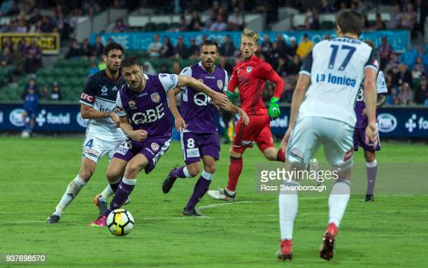Dino Djulbic of the Glory runs at James Donachie of the Victory during the round 24 ALeague match between the Perth Glory and the Melbourne Victory...