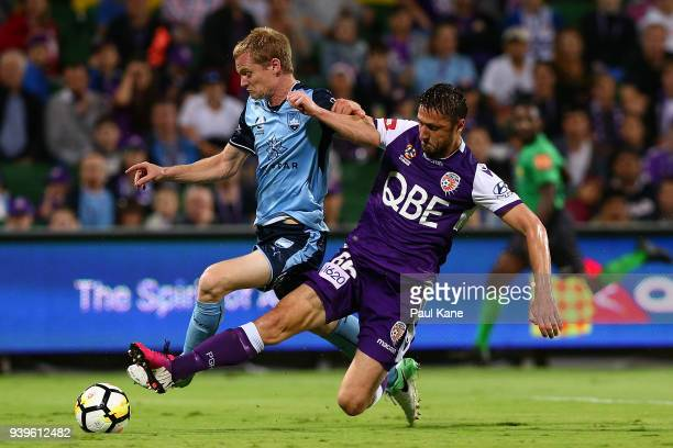 Dino Djulbic of the Glory tackles Matt Simon of Sydney during the round 25 ALeague match between the Perth Glory and Sydney FC at nib Stadium on...