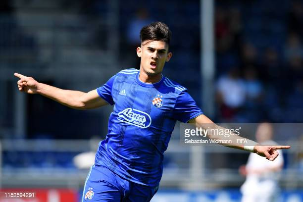 Dino Kapitanovic of Dinamo Zagreb celebrates scoring his sides first goal in the group stage match between Dinamo Zagreb and FC Blue Stars during day...