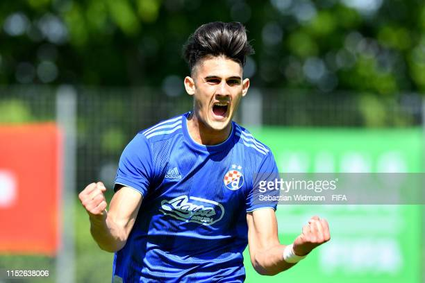 Dino Kapitanovic of Dinamo Zagreb celebrates scoring the opening goal in the group stage match between FC Sevilla and Dinamo Zagreb during day one of...