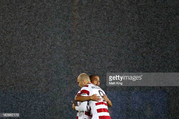 Dino Kresinger and Shinji Ono of the Wanderers embrace before the start of the round 23 A-League match between the Central Coast Mariners and the...