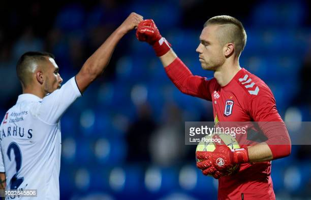 Dino Mikanovic and Goalkeeper Aleksandar Jovanovic of AGF Aarhus celebrate during the Danish Superliga match between Hobro IK and AGF Aarhus at DS...
