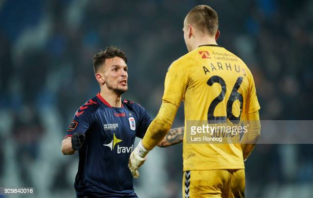 Dino Mikanovic and Goalkeeper Aleksandar Jovanovic of AGF Aarhus celebrate after the Danish Alka Superliga match between OB Odense and AGF Aarhus at...