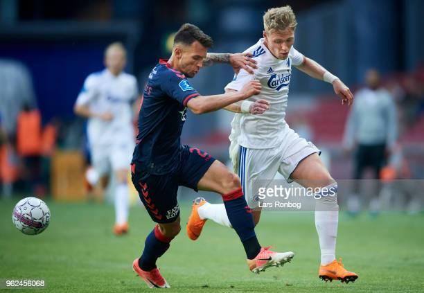Dino Mikanovic of AGF Aarhus and Viktor Fischer of FC Copenhagen compete for the ball during the Danish Alka Superliga Europa League Playoff match...