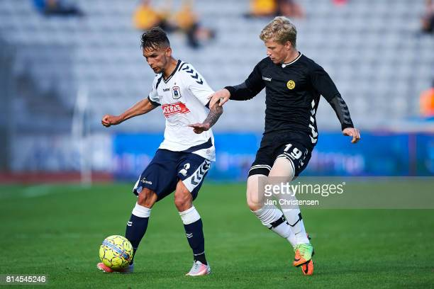 Dino Mikanovic of AGF Arhus and Tobias Arndal of AC Horsens compete for the ball during the Danish Alka Superliga match between AGF Arhus and AC...
