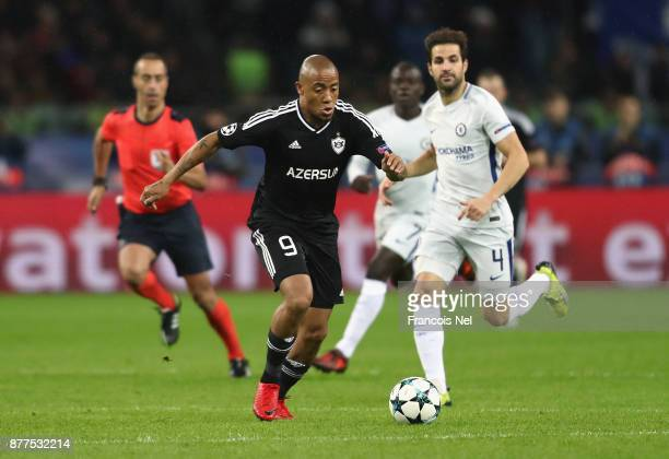 Dino Ndlovu of Qarabag FK and Cesc Fabregas of Chelsea battle for posession during the UEFA Champions League group C match between Qarabag FK and...