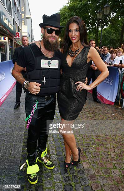 Dino Sadino and Anja Polzer attend the premiere of the film 'The Expendables 3' at Residenz Kino on August 6 2014 in Cologne Germany