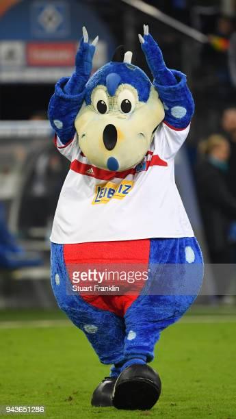 Dino the mascot of Hamburg celebrates during the Bundesliga match between Hamburger SV and FC Schalke 04 at Volksparkstadion on April 7 2018 in...