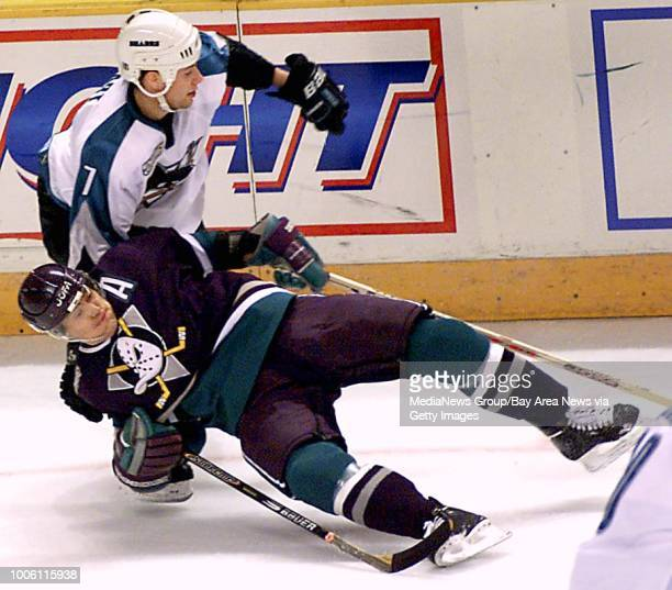 dino vournas/staff 2/29/00 tribune sports#13Sharks defenseman Brad Stuart mixes it up with Duck in first period action