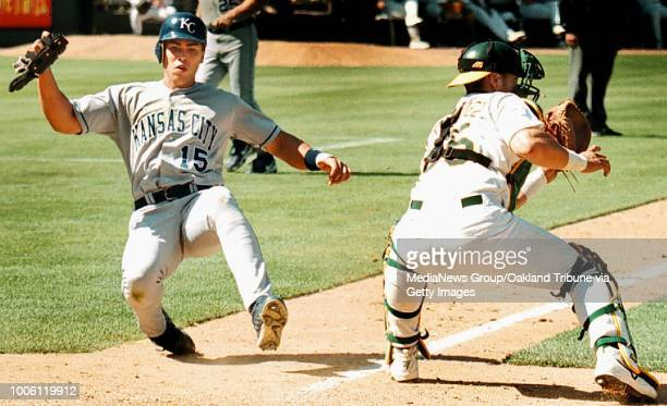 Dino vournas/staff 6/24/00 tribune sportsCarlos Beltran scores on a sacrifice fly by Mike Sweeney in the ninth inning. A's catcher Ramon...
