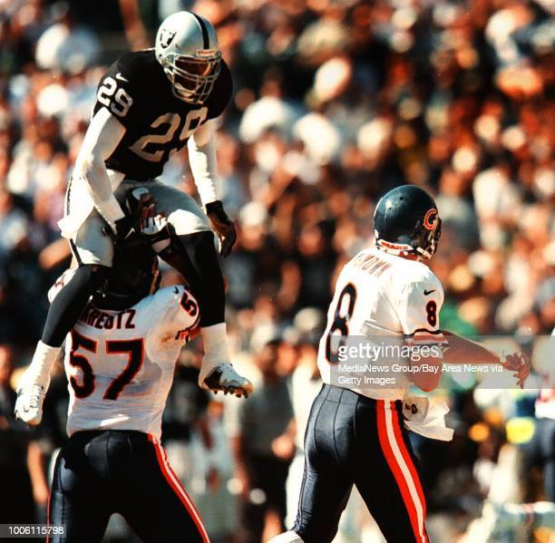 dino vournas/staff 9/26/99 tribune sports#13Eric Turner tries to get to QB Cade McNown over the top of Olin Kreutz