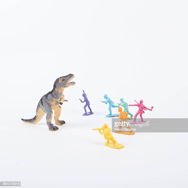 dino vs rainbow soldiers - army soldier toy stock pictures, royalty-free photos & images