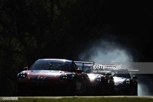 Dino Zamparelli of Redline Racing Porsche leads a pack of cars during the Porsche Carrera Cup GB race at Brands Hatch on September 30 2018 in...