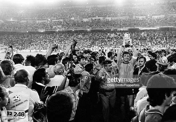 Dino Zoff captain of Italy carries the trophy through the crowd after defeating West Germany 31 in the FIFA World Cup Final at the Santiago Bernabeu...