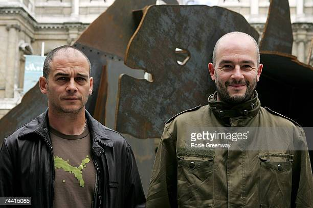 Dinos and Jake Chapman pose beside their artwork 'The Meek Shall Inherit The Earth, But Not The Mineral Rights' at The Royal Academy of Arts 239th...