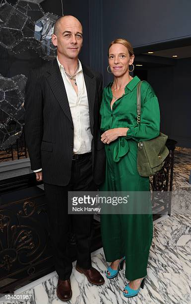Dinos Chapman and Tiphaine Chapman attend the dinner for Coach of which Gwyneth Paltrow is the new face on September 7 2011 in London England