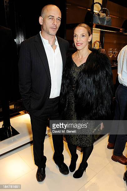 Dinos Chapman and Tiphaine de Lussy attend a private cocktail hosted by Gucci and Clara Paget to celebrate 'I Bamboo You' at Gucci's Old Bond Street...