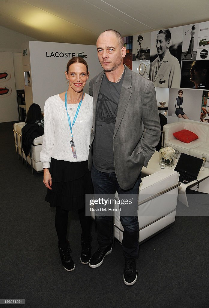 Dinos Chapman (R) and Tiphine Chapman attend the Lacoste VIP lounge during day eight of the ATP World Finals at the O2 Arena on November 12, 2012 in London, England.