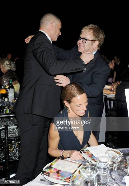 Dinos Chapman, Tiphaine de Lussy and Sir Elton John attend the Grey Goose Winter Ball to benefit the Elton John AIDS Foundation at Battersea...
