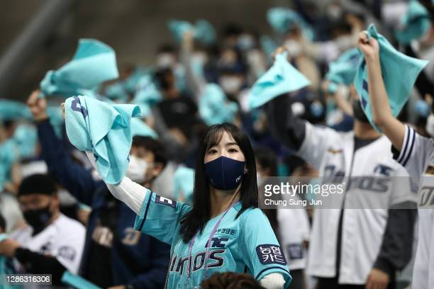 Dinos fans cheer in the bottom of seventh inning during the Korean Series Game Two between Doosan Bears and NC Dinos at the Gocheok Skydome on...
