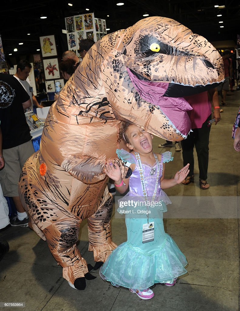A Dinosaur and princess attend the Long Beach Comic Con held at Long Beach Convention Center on September 17, 2016 in Long Beach, California.