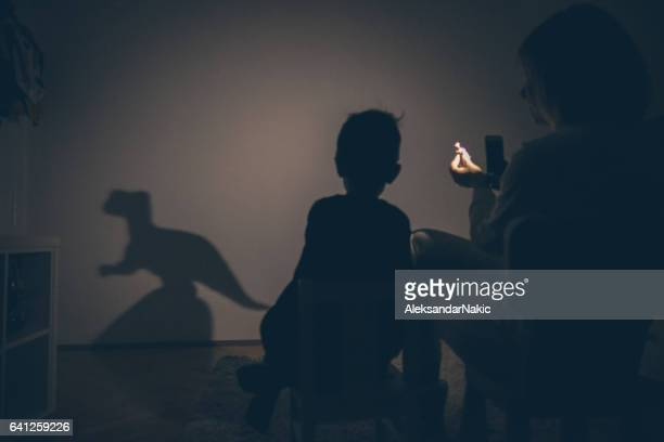 dinosaur in my room - shadow puppet stock photos and pictures