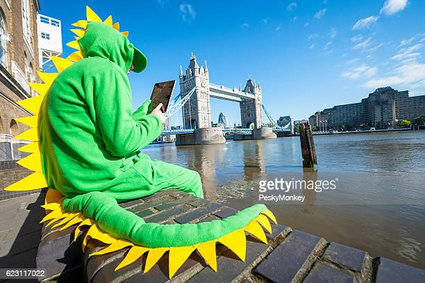 Dinosaur Man Sitting with Tablet in London