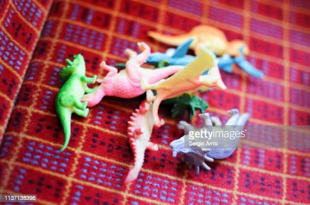 Dinosaur plastic toys scattered on train seat