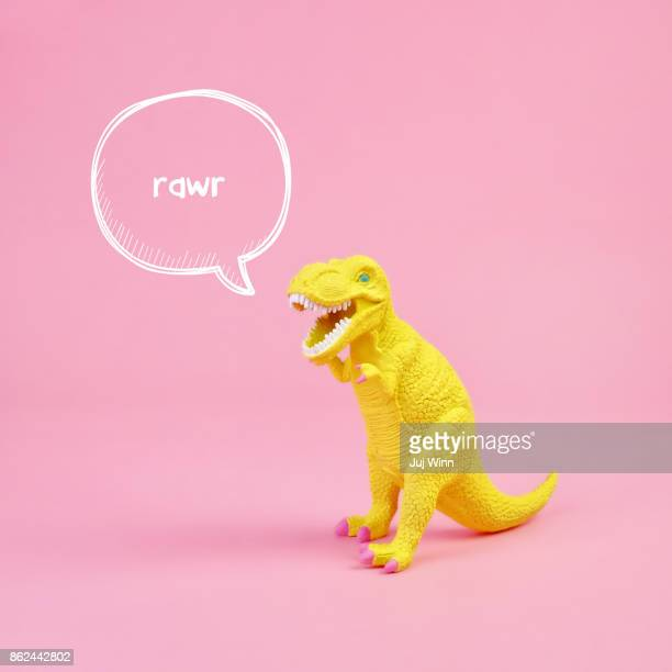dinosaur rawr - toy stock pictures, royalty-free photos & images
