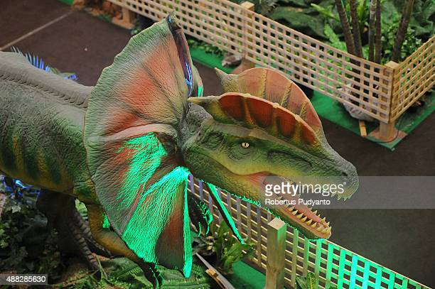 A dinosaur replica is displayed in the Dinosaur Adventure and Learning Experience Park at Tunjungan Plaza on September 15 2015 in Surabaya Indonesia...