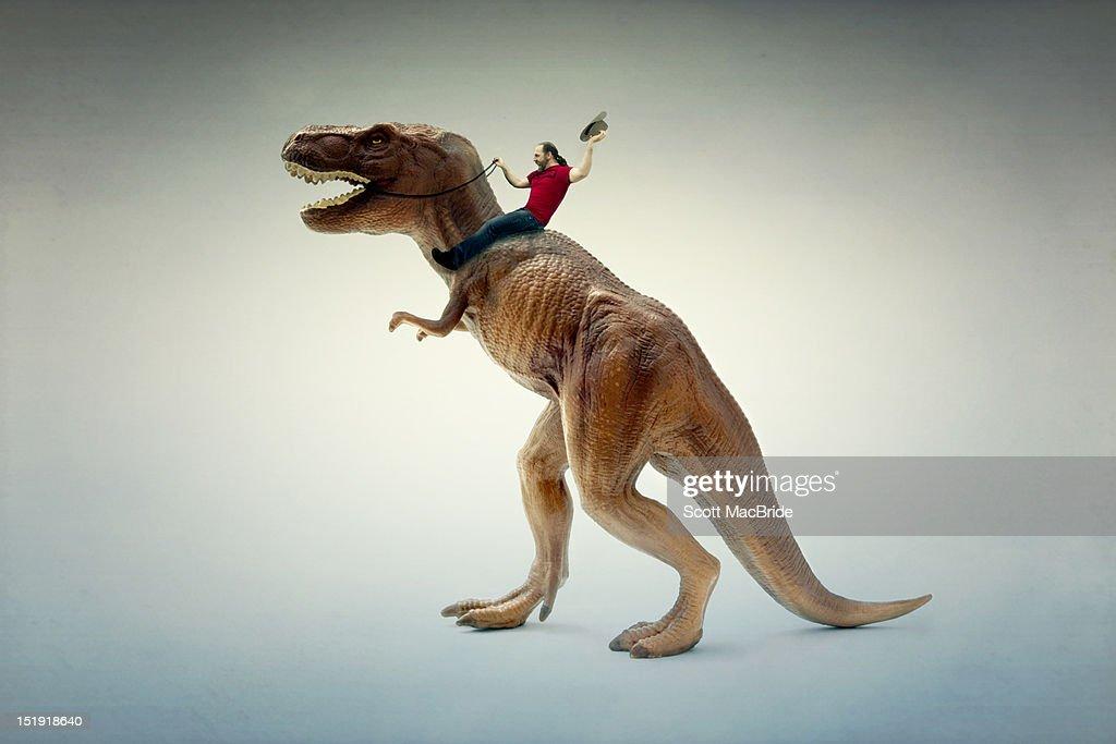Dinosaur rider : Stock Photo