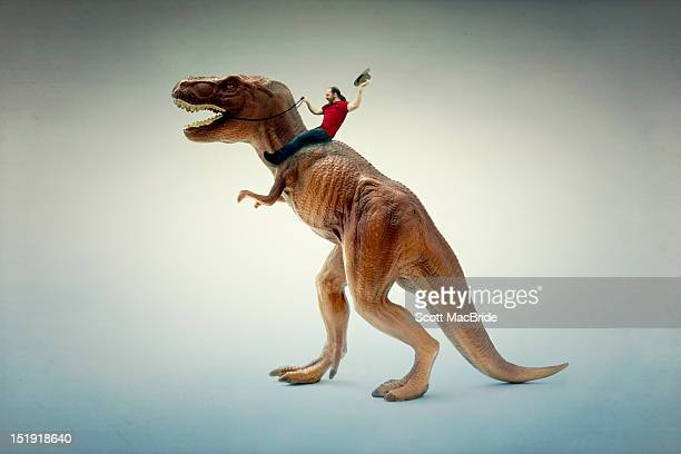 dinosaur rider - dinosaur stock pictures, royalty-free photos & images