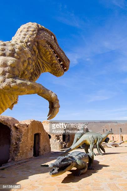 dinosaur sculptures at ksar de mourabitines - sauropoda stock pictures, royalty-free photos & images