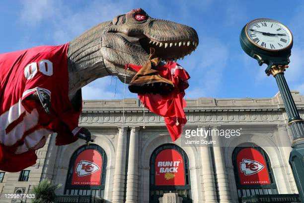 Dinosaur statue outside of Union Station in downtown Kansas City is clothed in a Kansas City Chiefs jersey as a Tampa Bay Buccaneer effigy dangles...