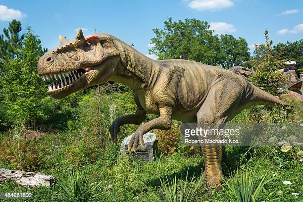 Dinosaurs Alive exhibition in Canada's Wonderland: Tyrannosaurus walking in the woods. Tyrannosaurus is a genus of coelurosaurian theropod dinosaur.