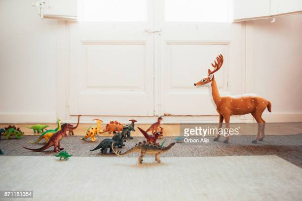 dinosaurs and reindeer - animal representation stock pictures, royalty-free photos & images
