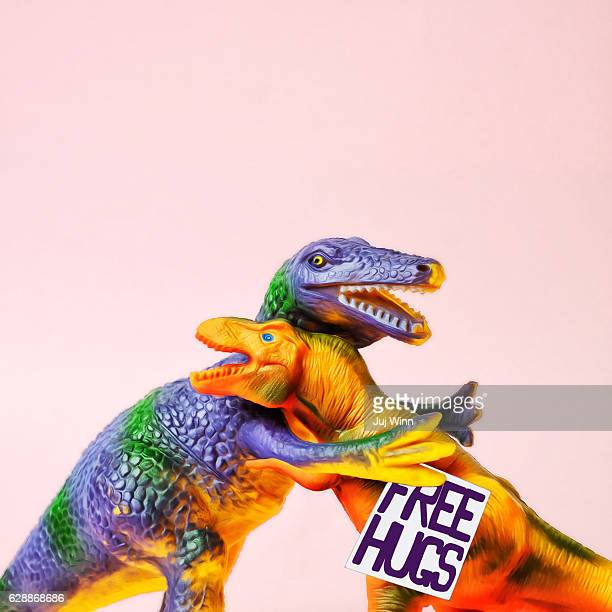 dinosaurs hugging - dinosaur stock pictures, royalty-free photos & images