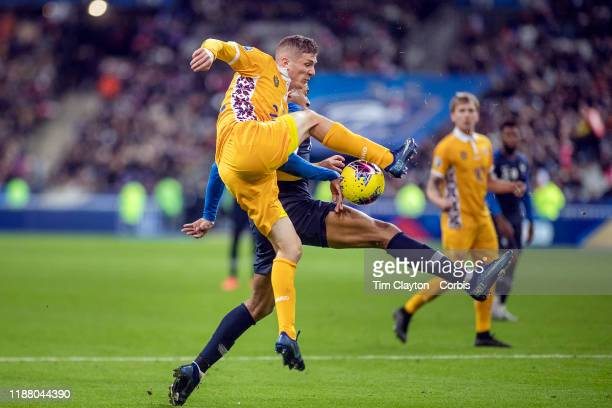Dinu Graur of Moldova attempts to tackle Kylian Mbappe of France during the France V Moldova 2020 European Championship qualifying group H match at...