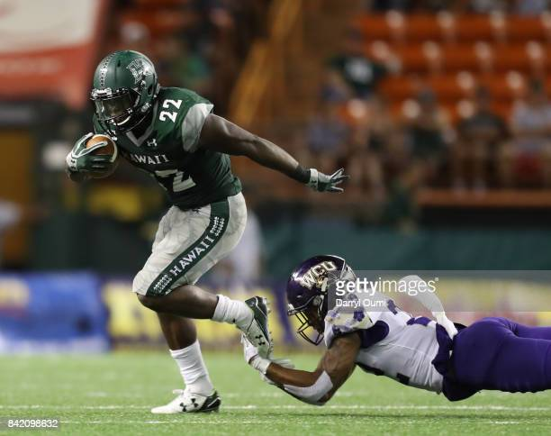 Diocemy Saint Juste of the Hawaii Rainbow Warriors breaks free from JerMichael White of the Western Carolina Catamounts in the third quarter of their...